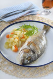 Baked sea bream with vegetables Royalty Free Stock Images