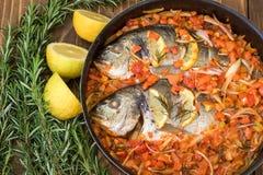 Baked sea fish. Mediterranean cuisine. Stock Photography