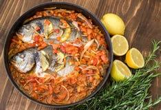 Baked sea fish. Mediterranean cuisine. Stock Image