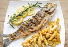 Baked seabass with fried potatoes Stock Image