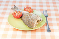 Baked seabass with tomatoes Stock Image