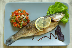 The baked seabass with vegetables Stock Photography