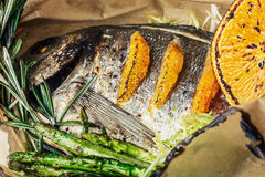 Baked seabass. Whole baked seabass with vegetable garnish. Healthy dinner Stock Images