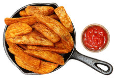 Baked Seasoned Potato Wedges in Cast Iron Skillet With Ketchup Royalty Free Stock Images