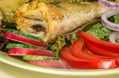 Baked shad with vegatables at dish Royalty Free Stock Image