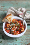 Baked shrimps and cherry tomatoes with feta cheese Royalty Free Stock Photo