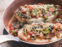 Baked Sicilian Swordfish in a Copper pan Royalty Free Stock Photo