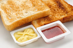 Baked slices of bread with jam and butter Royalty Free Stock Photos