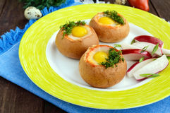 Baked small flavorful bun with bacon, cheese, quail egg and greens. Tasty breakfast Stock Image