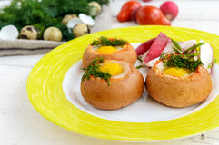 Baked small flavorful bun with bacon, cheese, quail egg. And greens. Tasty breakfast Stock Photography