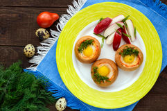 Baked small flavorful bun with bacon, cheese, quail egg and greens. Royalty Free Stock Photography