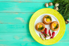 Baked small flavorful bun with bacon, cheese, quail egg and greens. Tasty breakfast. The top view Royalty Free Stock Image