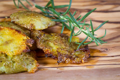 Baked smashed potatoes. Serving of potatoes that have been smashed and then baked with seasoned oil and spices as a side dish Stock Photo