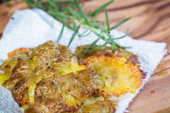 Baked smashed potatoes. Serving of potatoes that have been smashed and then baked with seasoned oil and spices as a side dish Stock Photography
