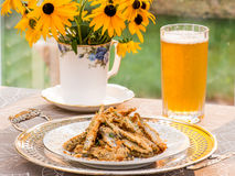 Baked smelt with bread crumbs and crushed nuts Stock Photos