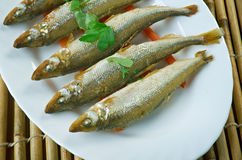Baked smelt. Served with roasted carrots Stock Photos