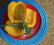 Baked Spaghetti Squash with rosemary garnish royalty free stock image