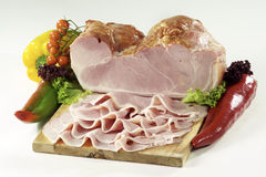 Baked speck. Isolated on cutting board Stock Image