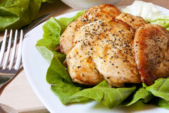 Baked chicken breast with salad Royalty Free Stock Images