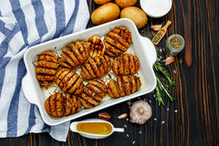 Baked spicy potatoes in baking dish Royalty Free Stock Images