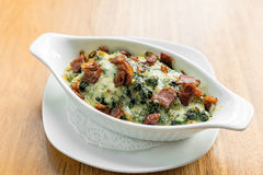 Baked spinach with cheese Royalty Free Stock Photos