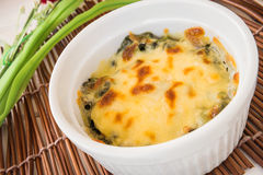 Baked spinach with cheese Royalty Free Stock Image