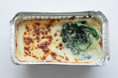 Baked spinach with cheese in froid package Royalty Free Stock Photography