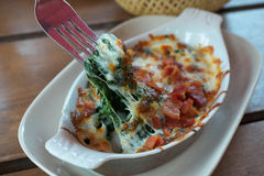 Baked spinach with cheese or spinach au gratin. Close-up of Baked spinach with cheese or spinach au gratin Stock Photos