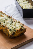 Baked spinach souffle. Baked healthy spinach souffle on cutting board Royalty Free Stock Photography