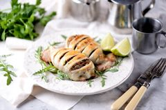 Baked squid stuffed with onions, carrots and mushrooms Royalty Free Stock Photo