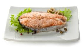 Baked steak of salmon with vegetables, lettuce and pepper Stock Photo