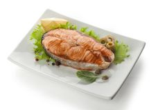 Baked steak of salmon with olives and lemon Royalty Free Stock Photos