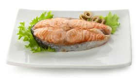Baked steak of salmon with olives and lettuce Stock Photography