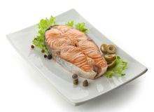 Baked steak of salmon with vegetables, lettuce and pepper Royalty Free Stock Photo