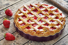 Baked strawberry pie cake sweet pastry on rustic table Royalty Free Stock Image