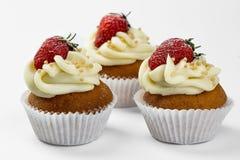 Baked strawberry tart on white background. Baked strawberry dessert with cream. Sweet strawberry tart isolated on white background. Tasty cupcake with Royalty Free Stock Photography