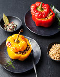 Baked stuffed bell peppers filled with spelt wheat, rice, vegetables Stone background Stock Images