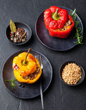 Baked Stuffed Bell Peppers Filled With Spelt Wheat, Rice, Vegetables Stone Background Royalty Free Stock Photo