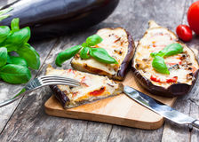 Baked stuffed eggplant with cheese and tomatoes Royalty Free Stock Image