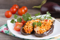 Baked stuffed eggplant with meat, vegetables and cheese. Royalty Free Stock Photo