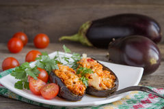 Baked stuffed eggplant with meat, vegetables and cheese. Stock Image