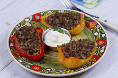 Baked Stuffed Peppers with Meat, Wild Rice, Vegetables and Greens Royalty Free Stock Photos