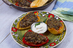 Baked Stuffed Peppers with Meat, Wild Rice, Vegetables and Greens. Royalty Free Stock Photography