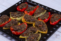 Baked Stuffed Peppers with Meat, Wild Rice, Vegetables and Greens. Royalty Free Stock Image