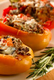 Baked stuffed red bell pepper Stock Photos