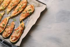 Baked stuffed zucchini with meat in a pan Royalty Free Stock Image