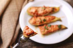 Baked stuffed zucchini with meat on a plate. Royalty Free Stock Photos