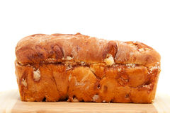 Baked sugar bread in closeup on cutting board Royalty Free Stock Photo