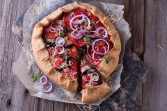 Baked Summer Vegetable open pie or Galette with Tomato, Aubergine, Garlic and cheese. Royalty Free Stock Images