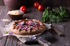 Baked Summer Vegetable open pie or Galette with Tomato, Aubergine, Garlic and cheese. Stock Photography